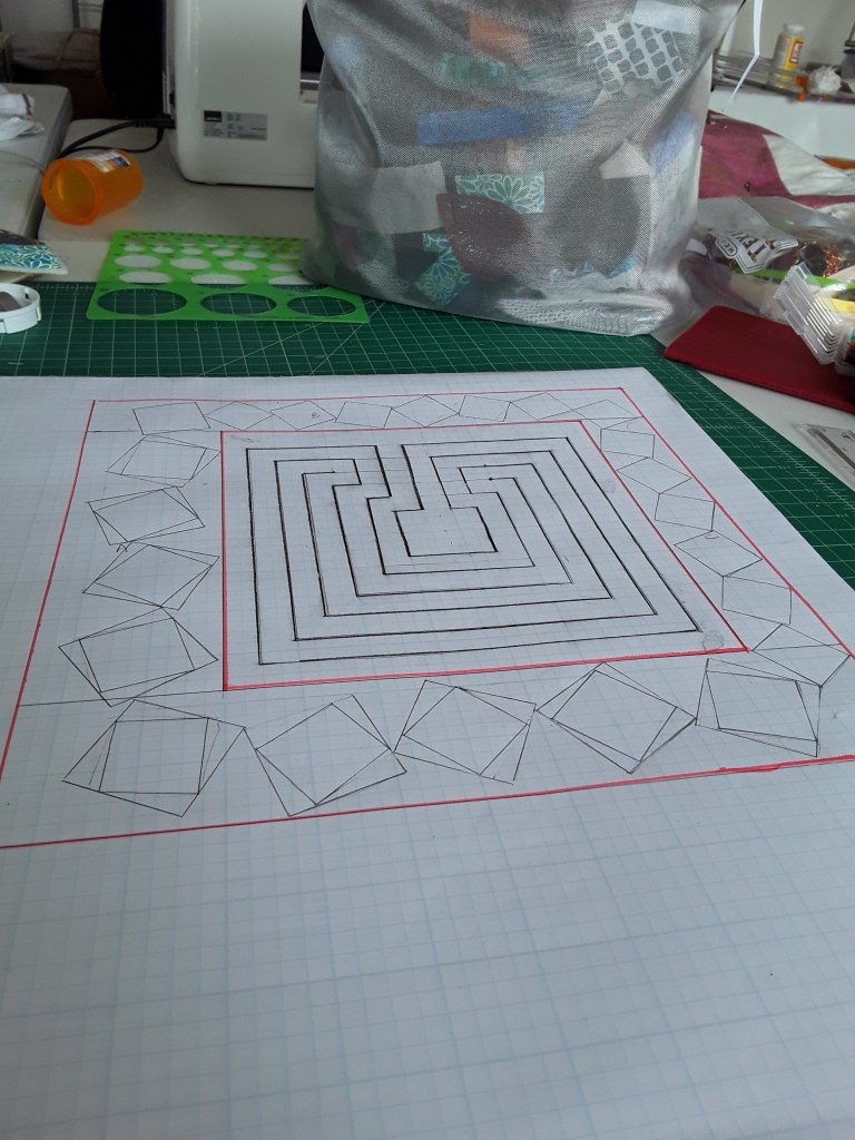 drawing design for tumbling blocks on a quilt. Done with a walking foot