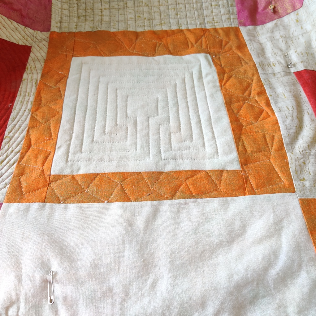 Finished block from design of tumbling Blocks. Quilting done by walking foot